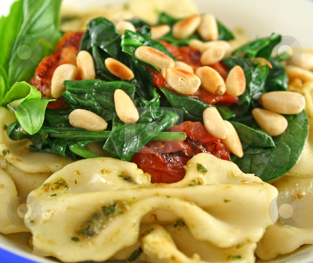 Pasta With Pine Nuts 4 stock photo, Pasta with pesto and spinach, cherry tomatoes and pine nuts. by Brett Mulcahy
