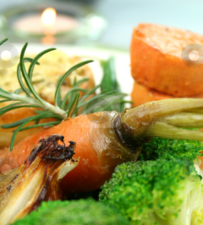 Baked Carrot And Rosemary stock photo, Baked whole carrot and rosemary with broccoli, sweet potato and onion. by Brett Mulcahy
