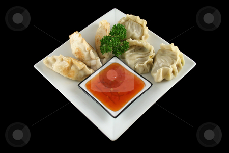 Chinese Dumplings 1 stock photo, Delicious fried pork and vegetable Chinese dumplings ready to serve. by Brett Mulcahy
