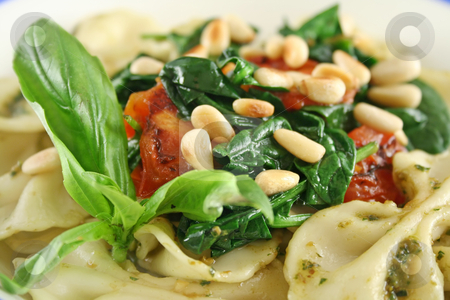 Pasta With Pine Nuts 2 stock photo, Pasta with pesto and spinach, cherry tomatoes and pine nuts. by Brett Mulcahy