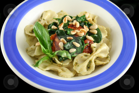 Pasta With Pine Nuts 1 stock photo, Pasta with pesto and spinach, cherry tomatoes and pine nuts. by Brett Mulcahy