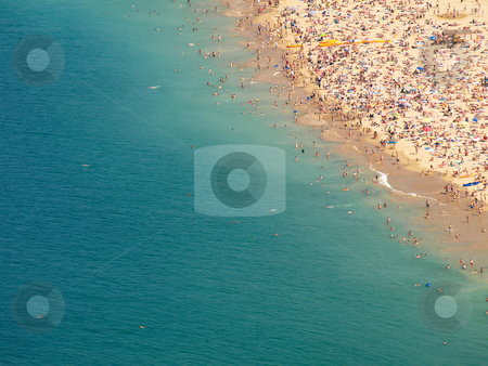 Crowded beach shore stock photo, Concha bay shore  in San Sebastian Spain by Laurent Dambies