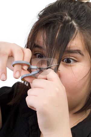 Hair Trim stock photo, A young girl trimming her own bangs by Richard Nelson