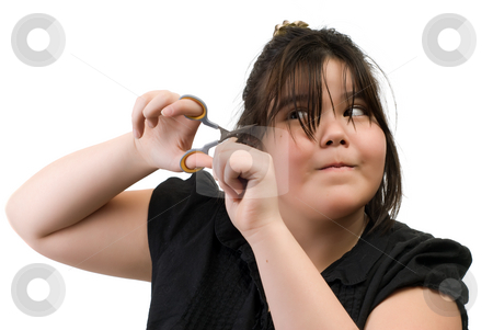 Cutting Hair stock photo, A young girl trying to cut her own hair, isolated against a white background by Richard Nelson