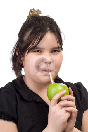 Juicy Fruit stock photo, A young girl drinking the juice out of an apple, isolated against a white background by Richard Nelson