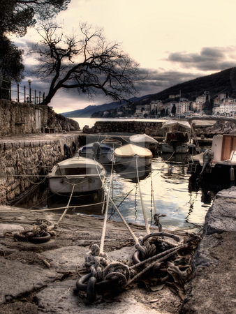 Winter in Opatija stock photo, Artistic view on boat in small harbor, in Opatija,Croatia by Sinisa Botas