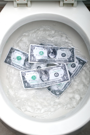 Dollar bills being flushed down a white toilet stock photo, Dollar bills being flushed down a white toilet, representing the economy going down the toilet by Vince Clements