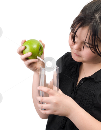 Apple Juice stock photo, Concept image of some fresh apple juice being poured into a glass by Richard Nelson