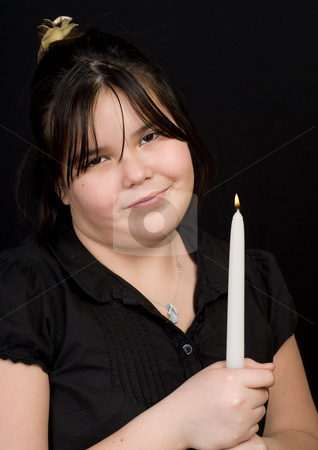 Amused Child stock photo, A young girl holding a lit candle with an amused look on her face by Richard Nelson