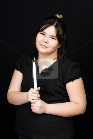 Innocent Girl stock photo, A young innocent girl holding a white candle, shot against a dark background by Richard Nelson