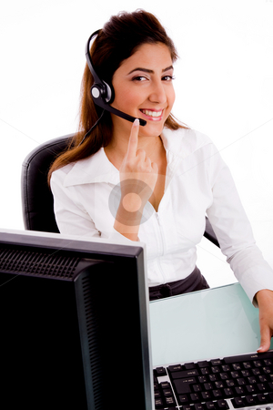 Side pose of smiling telecaller stock photo, Side pose of smiling telecaller on an isolated background by Imagery Majestic