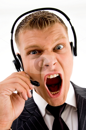 Frustrated customer complaining and shouting on phone call stock photo, Frustrated customer complaining and shouting on phone call on an isolated white background by Imagery Majestic