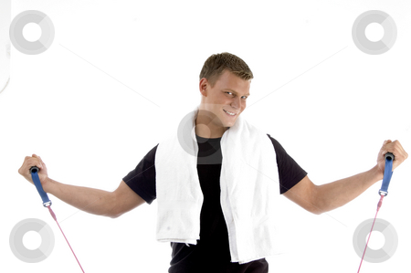 Happy male with exercising rope stock photo, Happy male with exercising rope on an isolated background by Imagery Majestic