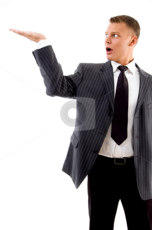 Adult handsome man looking his palm stock photo, Adult handsome man looking his palm on an isolated background by Imagery Majestic
