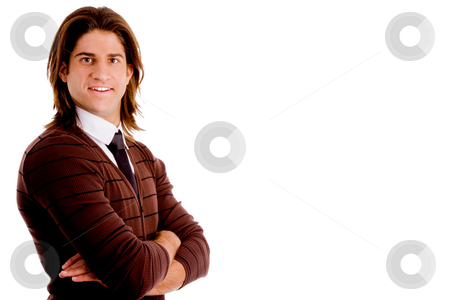 Young college student stock photo, Side pose of young man with folded hands with white background by Imagery Majestic