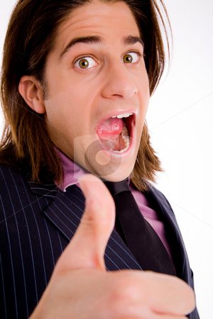 Happy man approving thumbs up stock photo, Sidepose of shouting male with thumbsup on an isolated background by Imagery Majestic