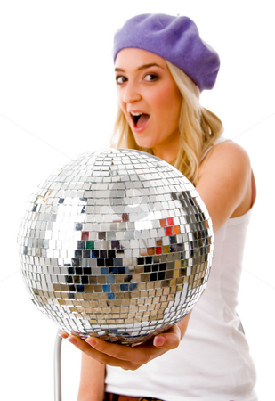 Side view of young female showing disco mirror ball stock photo, Side view of young female showing disco mirror ball against white background by Imagery Majestic