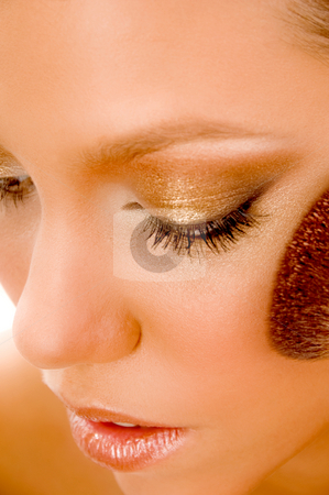 Close up of model using blusher stock photo, Close up of model using blusher against white background by Imagery Majestic