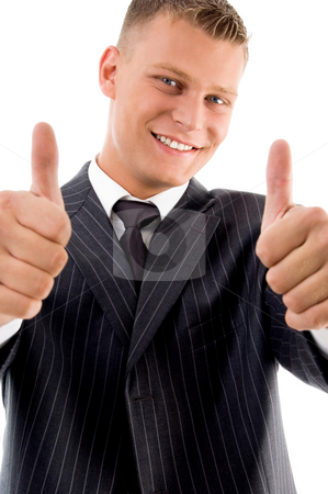 Smiling handsome boss showing thumb up with both hands stock photo, Smiling handsome boss showing thumbs up with both hands on an isolated background by Imagery Majestic