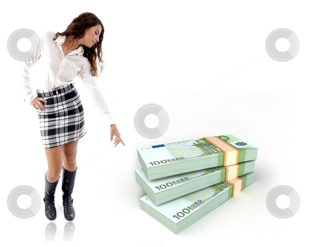 Woman pointing at the bundle of notes stock photo, Standing woman pointing the bundle of three dimensional notes by Imagery Majestic