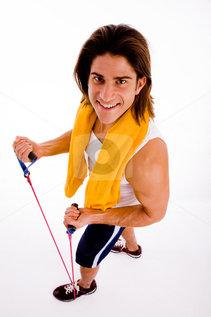 High angle view of man exercising with rope stock photo, High angle view of man exercising with rope with white background by Imagery Majestic