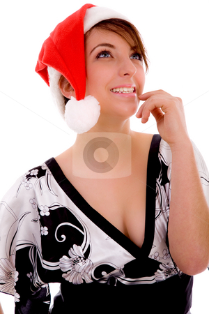 Front view of cheerful woman in christmas hat stock photo, Front view of cheerful woman in christmas hat against white background by Imagery Majestic