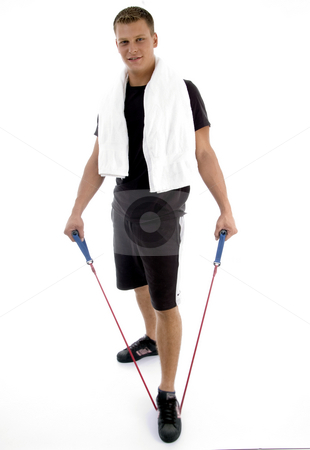 Standing man with exercising rope stock photo, Standing man with exercising rope on an isolated background by Imagery Majestic