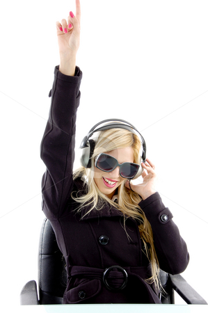 Front view of pointing woman enjoying music stock photo, Close view of woman enjoying music with white background by Imagery Majestic