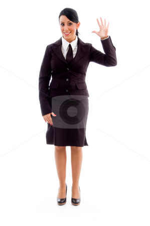 Young businesswoman showing counting hand gesture stock photo, Young businesswoman showing counting hand gesture on an isolated white background by Imagery Majestic