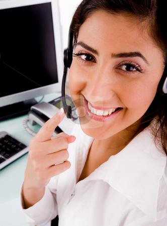 Smiling telecaller operator stock photo, Side pose of smiling telecaller on an isolated white background by Imagery Majestic