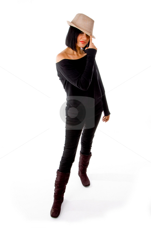 Front view of standing model wearing hat stock photo, Front view of standing model wearing hat on an isolated background by Imagery Majestic