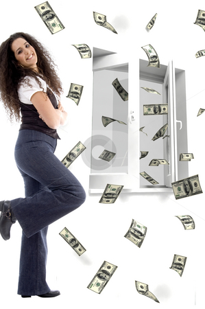 Smiling young woman and flying dollars stock photo, Smiling young woman and three dimensional flying dollars notes out of a window by Imagery Majestic