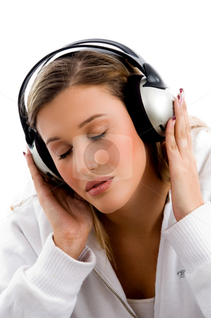 Young female busy with music stock photo, Young female busy with music against white background by Imagery Majestic