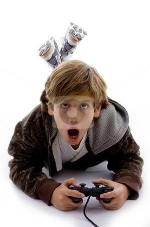 Front view of surprised kid playing videogame  stock photo, Front view of surprised kid playing videogame on an isolated white background by Imagery Majestic
