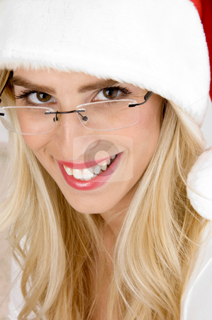 Front view of smiling woman in christmas hat stock photo, Front view of smiling woman in christmas hat by Imagery Majestic