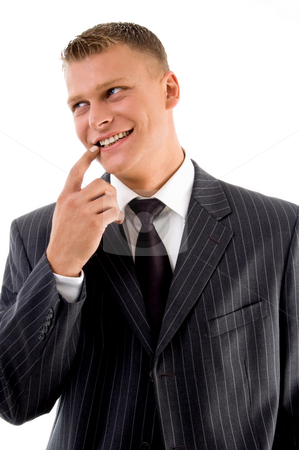 Smiling professional looking sideways stock photo, Smiling professional looking sideways against white background by Imagery Majestic