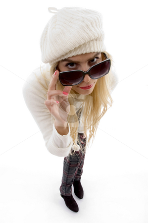 High angle view of woman looking through sunglasses stock photo, High angle view of woman looking through sunglasses on an isolated white background by Imagery Majestic