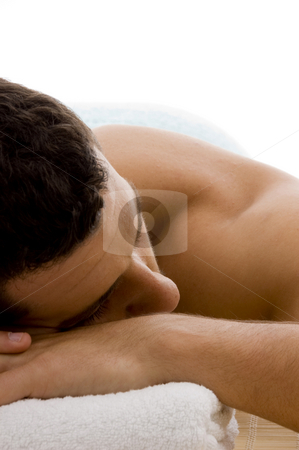 Front view of man in spa resort on mat stock photo, Front view of man in spa resort on mat by Imagery Majestic