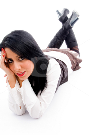 Female model lying down on floor and looking at camera stock photo, Female model lying down on floor and looking at camera against white background by Imagery Majestic