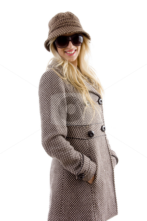 Side view of smiling female in overcoat stock photo, Side view of smiling female in overcoat on an isolated white background by Imagery Majestic