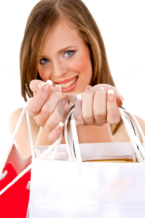 Front view of smiling female showing carrybags stock photo, Front view of smiling female showing carrybags on an isolated white background by Imagery Majestic