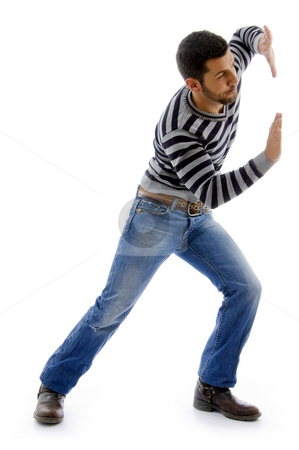 Side view of active male dancing stock photo, Side view of active male dancing on an isolated white background by Imagery Majestic