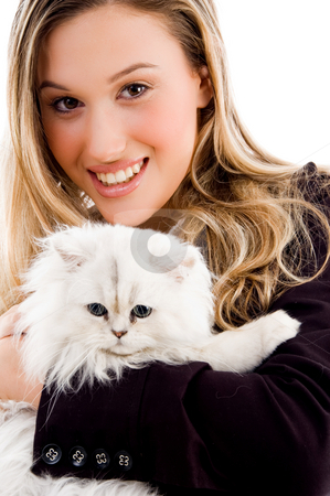 Female smiling and posing with cat stock photo, Female smiling and posing with cat on an isolated white background by Imagery Majestic
