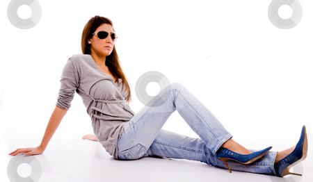 Young female with sunglasses looking aside stock photo, Side view of young female with sunglasses looking aside on an isolated white background by Imagery Majestic
