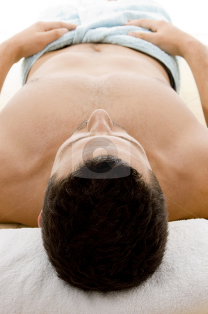Front view of man lying down for spa treatment  stock photo, Front view of man lying down for spa treatment by Imagery Majestic