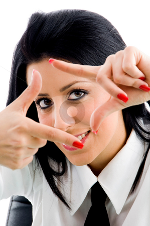 Woman with framing hand gesture stock photo, Woman with framing hand gesture on an isolated background by Imagery Majestic