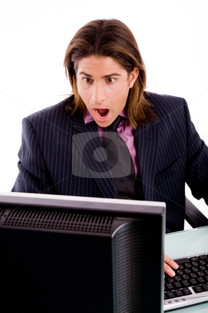 Front view of shocked manager looking at screen stock photo, Front view of shocked manager looking at screen against white background by Imagery Majestic