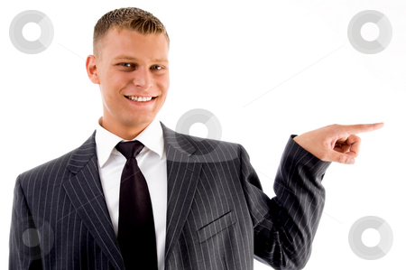 Pointing businessman looking at camera stock photo, Pointing businessman looking at camera with white background by Imagery Majestic