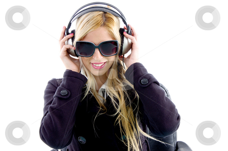 Portrait of woman enjoying music stock photo, Portrait of woman enjoying music on an isolated white background by Imagery Majestic