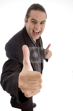 Happy businessman wishing goodluck stock photo, Happy businessman wishing goodluck against white background by Imagery Majestic